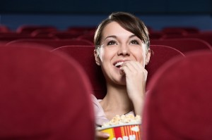 woman watching a movie alone