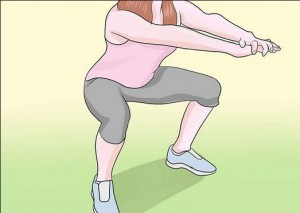 Squats help reduce the fat on hips and thighs
