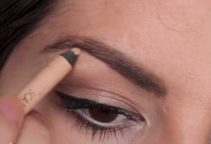Add a touch of nude liner around the edges of your eyebrow to define it and make it look crisp