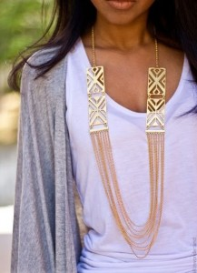 This long-chain gold statement necklece adds an element of bling to a simple outfit