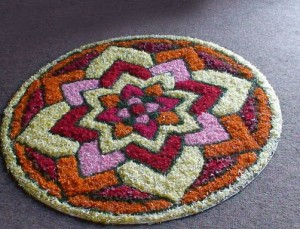 You can decorate your kitchen with a flower rangoli such as this one made of marigold