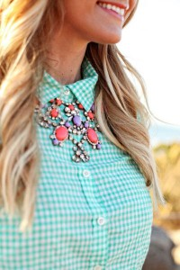 Coral coloured statement necklace looks great with a checked-collared shirt