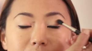 You can use your small blending brush to apply eye shadow to your lids
