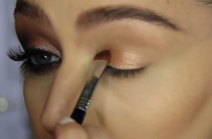 Pack on the base colour on your eyelid using an eye shadow brush