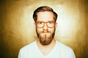 A typical hipster beard is a long, full beard, usually combined with a clean pompadour haircut.