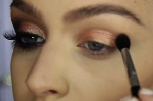 Apply the bronze eye shadow in the crease and on the outer corner and gently blend