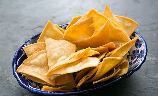 Tortilla chips and salsa dip make for great nibbles at a party