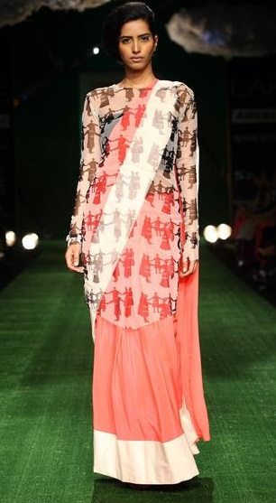 This style includes wearing a sheer tunic that compliments the colours in your outfict over your sari