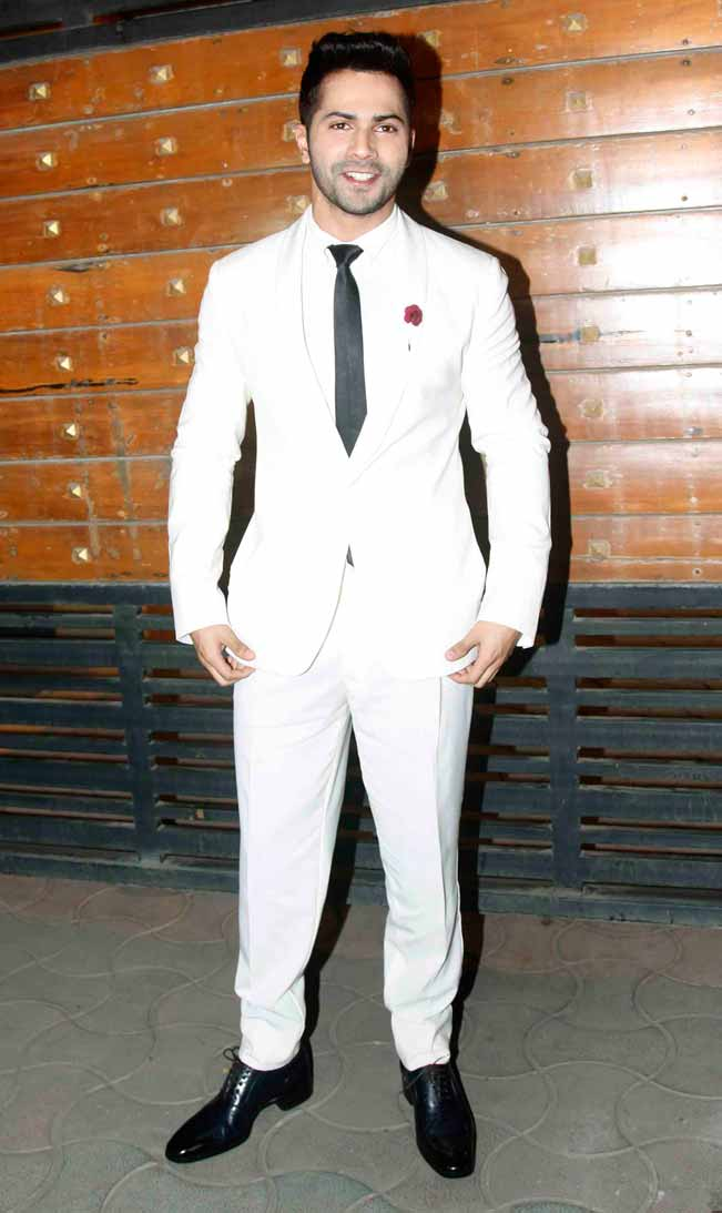 Varun Dhawan looked really dapper in an all white suit