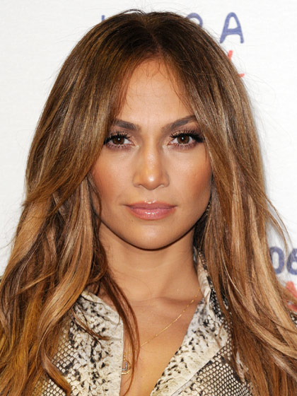 get caramel and honey highlights-lowlights like JLo's if you have dark brown hair, highlights and lowlights,