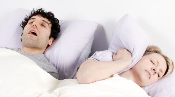 Man snoring and wife getting disturbed, see a sleep doctor,