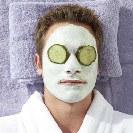 man lying with face pack on and cucumber slices on eyes, natural remedies to remove sun tan