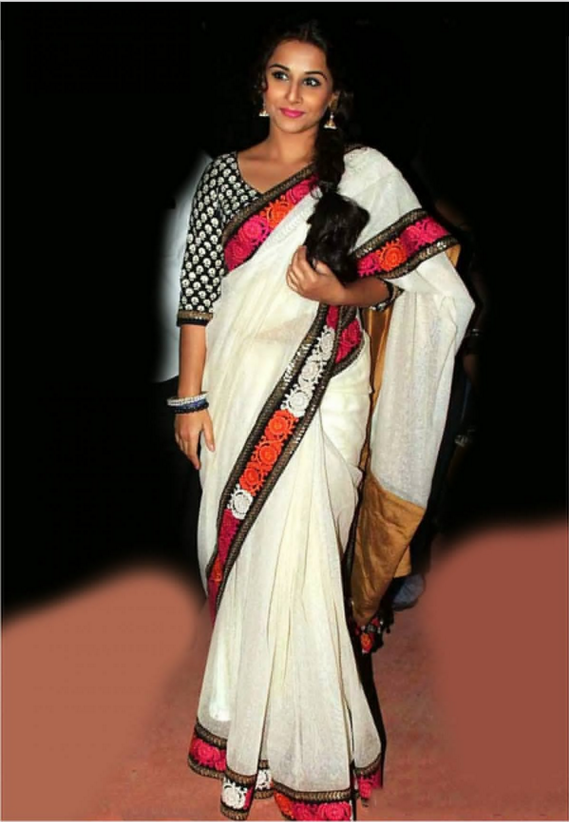 Doesn't Vidya look smart in a simple saree and a detailed striking blouse?