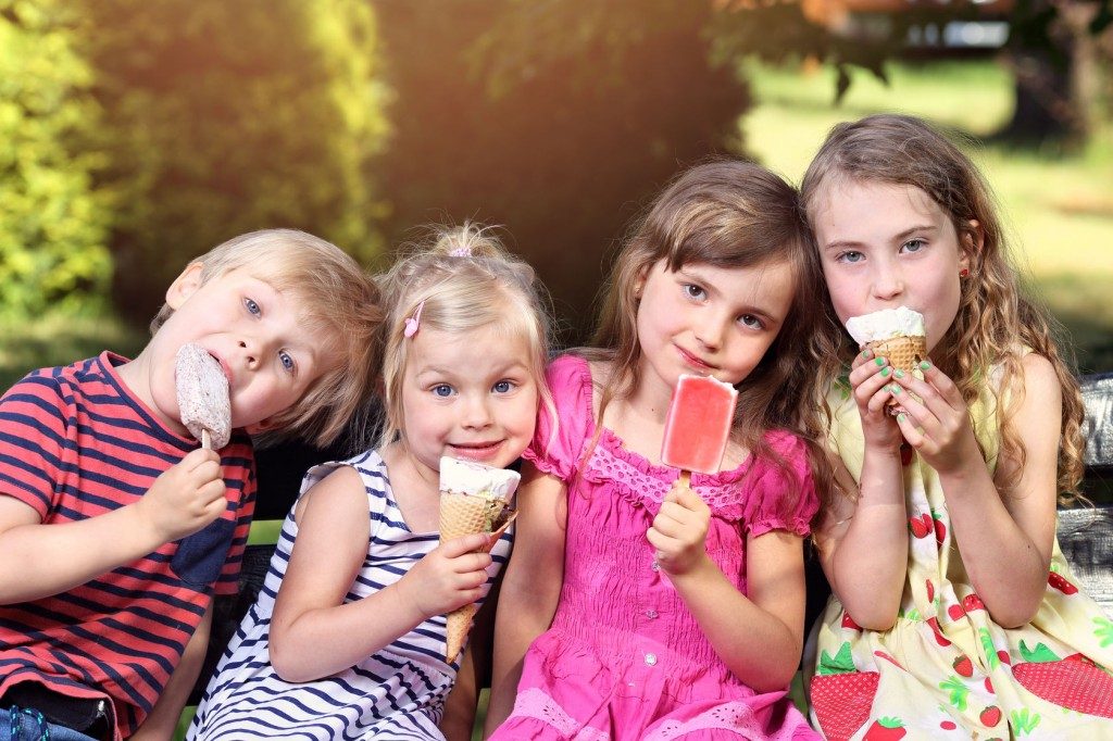 40758685 - adorable children eating ice cream on holiday